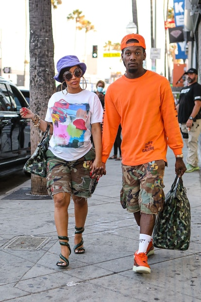 Cardi B and Offset wore matching camo shorts and bags in July 2021.