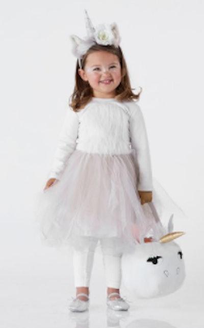 A child unicorn costume