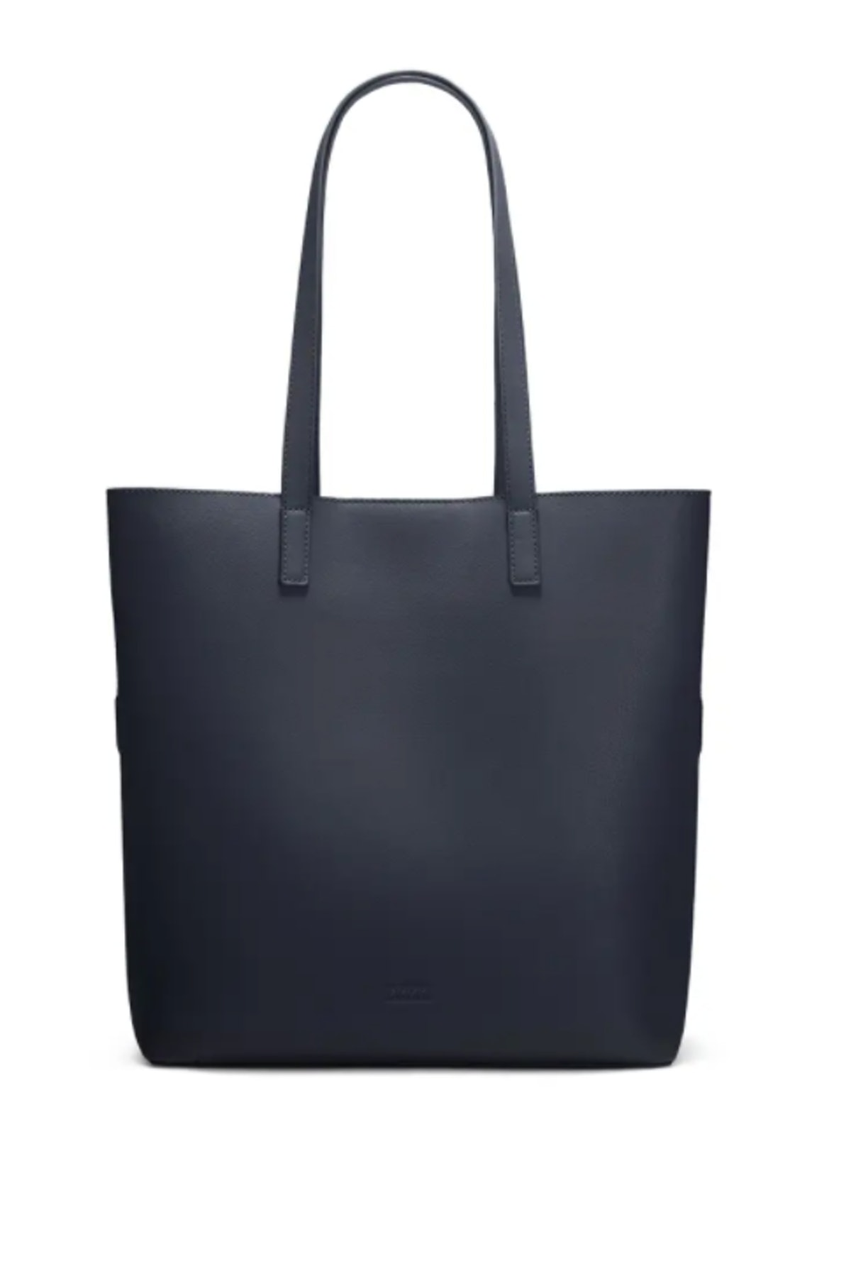 AWAY's Longitude Tote in navy leather that can hold a laptop.