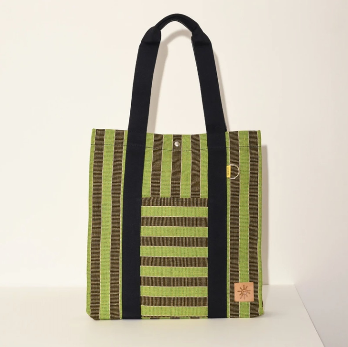 Goodee's Bassi Market Tote in Green and Mimosa Stripe that can hold a laptop.