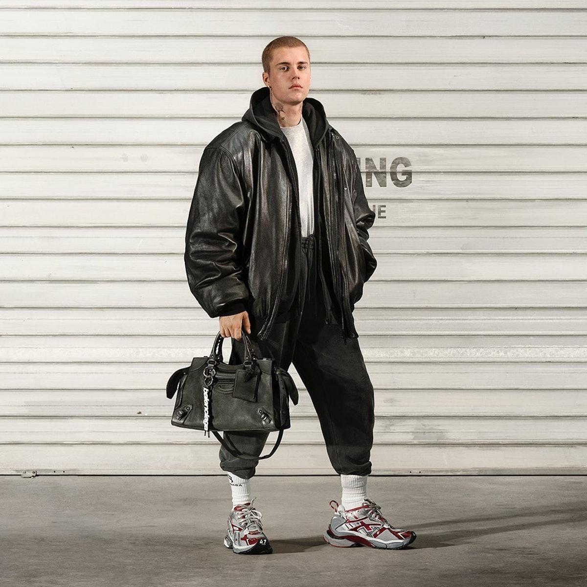 Justin Bieber with a Balenciaga handbag.