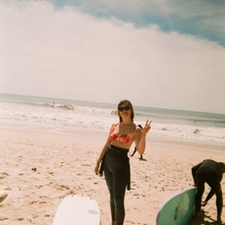 Aemilia Madden surfing