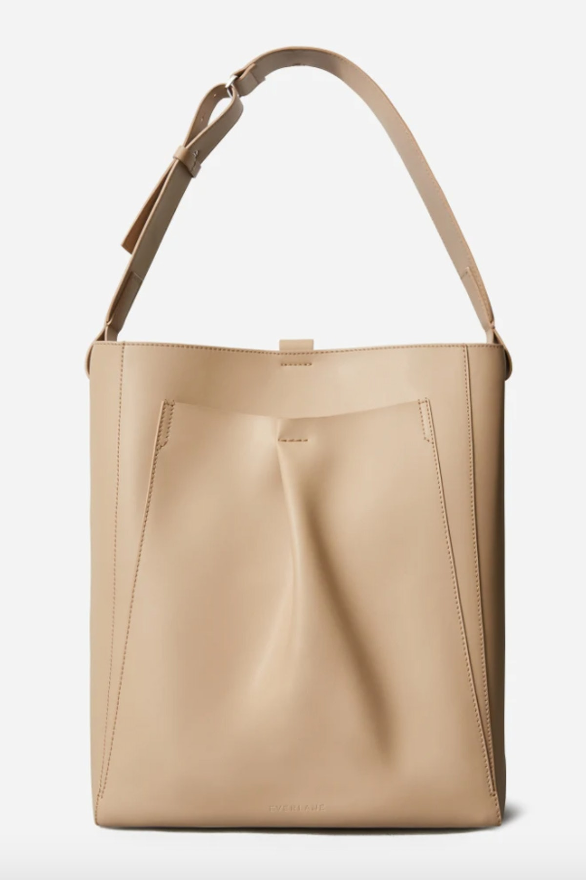 Everlane's Italian Leather Studio Bag In Light Taupe that can fit a laptop.