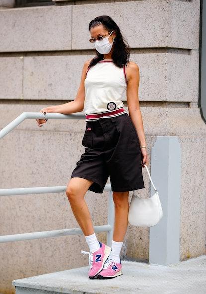 Bella Hadid wearing New Balance x Aime Leon Dore sneakers.