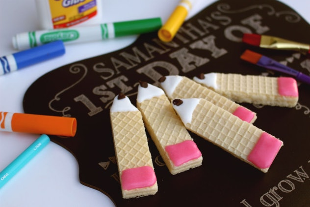 rectangular wafer cookies decorated with icing to look like pencils with pink erasers