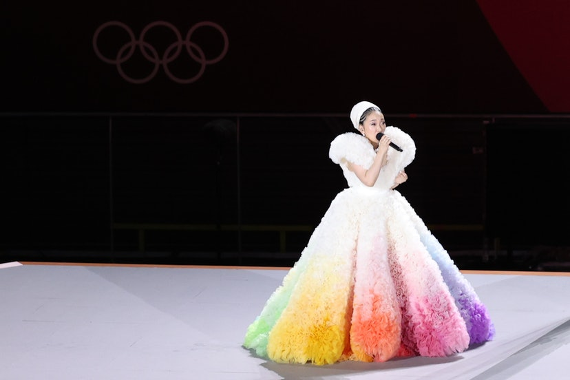 Singer Misia performs a Japanese national anthem as a Japanese national flag being raised during the...