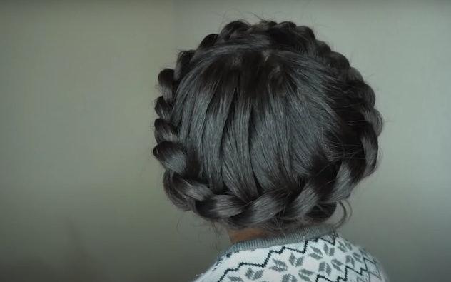 Little girl with dark hair with halo braid around her head