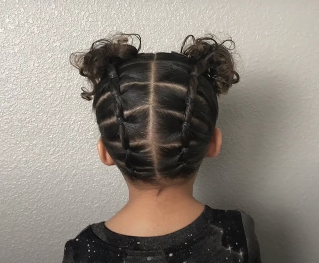 Back of little girl's head, showing off pigtail hair style with sections in bands for style