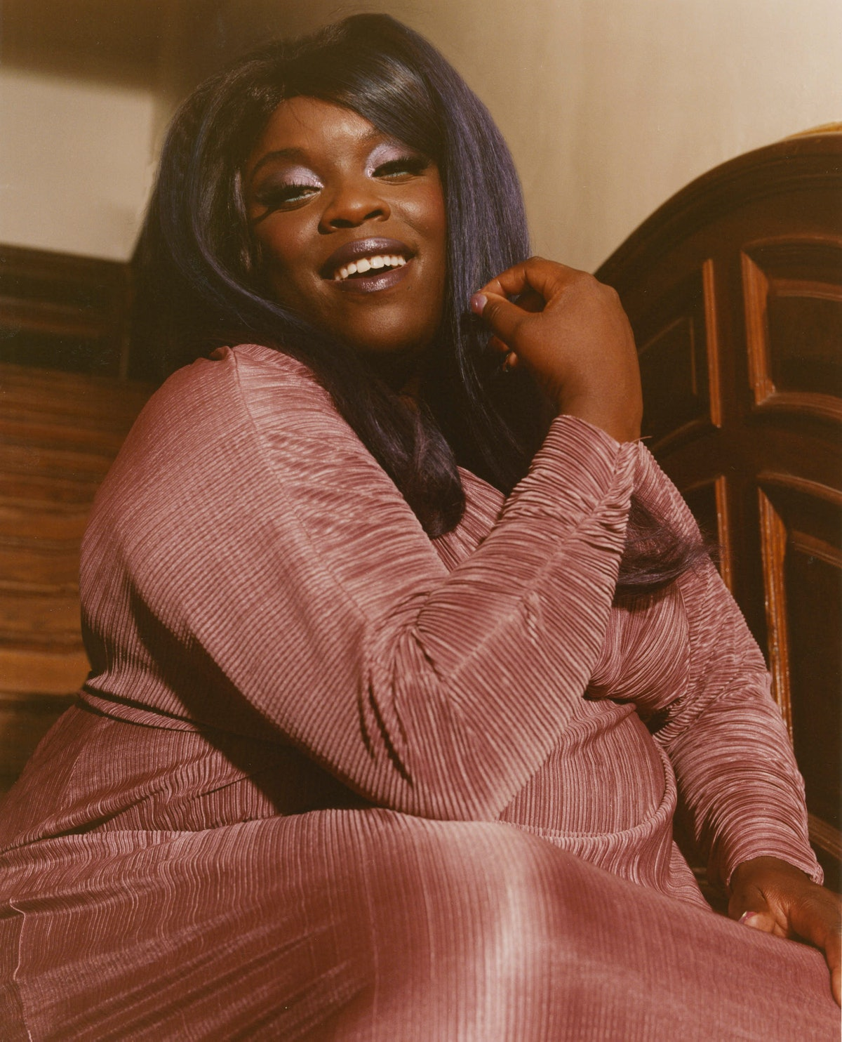 Yola in a pink pleated dress
