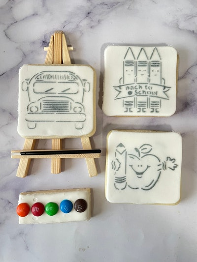 fondant cookie that can be painted with edible paint, comes with small wooden easel