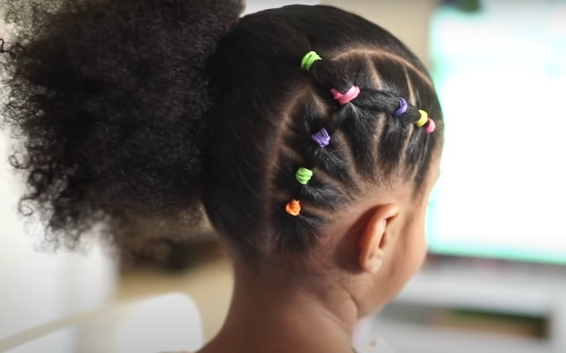 Young girl with natural hair styled with colorful bands