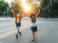 2 friends walking together holding hands in the city at sunset before posting funny birthday caption...