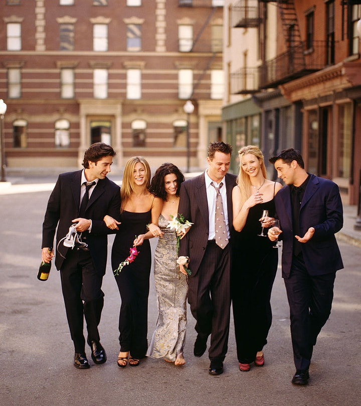 """Cast of """"Friends"""" TV show linking arms, walking down a street"""