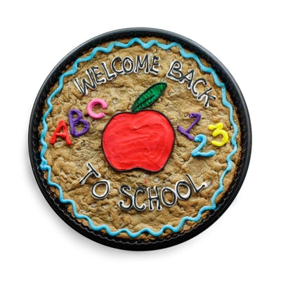 a chocolate chip cookie cake topped with a welcome back to school message