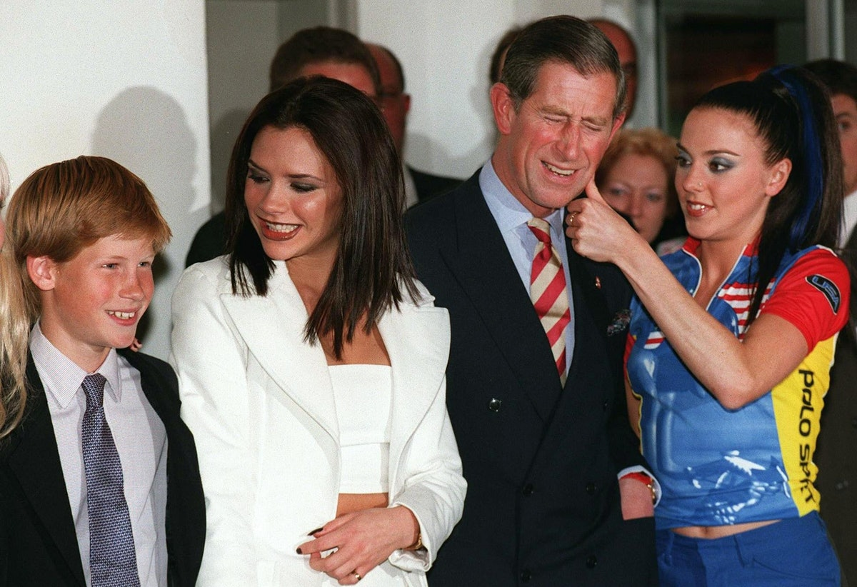 Prince Harry (L) poses with Spice Girls Victoria (2D L) as his father, HRH Prince Charles (2D R), ge...