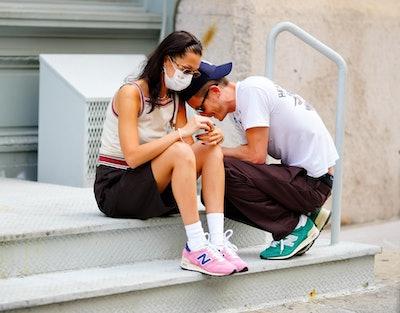 Bella Hadid and Marc Kalman wearing matching New Balance x Aime Leon Dore sneakers.