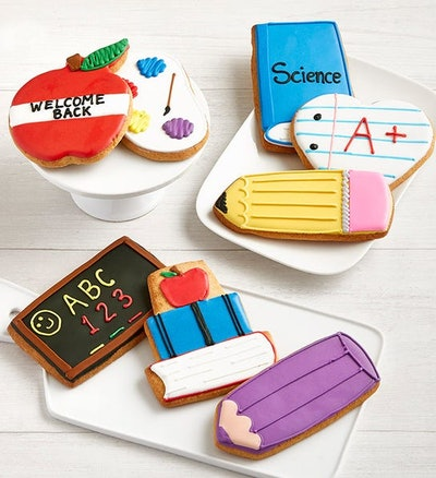 sugar cookies decorated for back-to-school. Iced to look like pencils, apples, and books