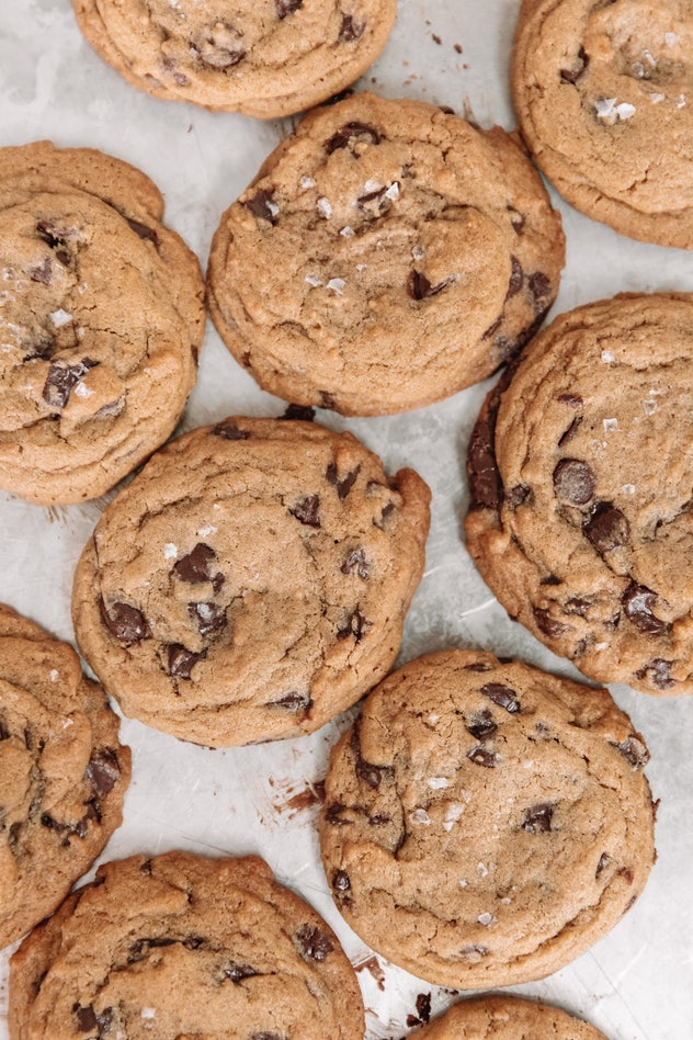 chocolate chip cookies topped with flaky sea salt, shot from above
