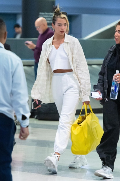 Singer Dua Lipa rocks a relaxed look as she arrives at JFK Airport in New York.