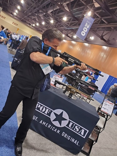 Private eye Jake Schmidt tries an AR-15 at the National Sheriffs' Association in Phoenix 2021
