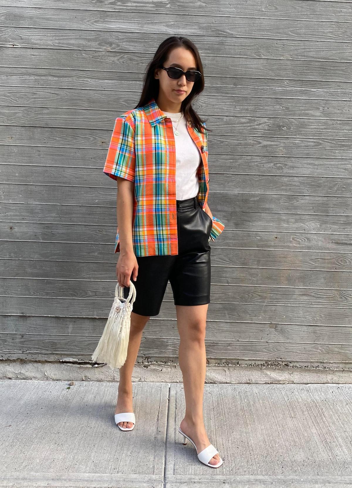 Marina Liao carrying a Petit Kouraj bag.