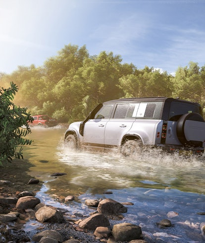 cars racing through water in Mexican canyon