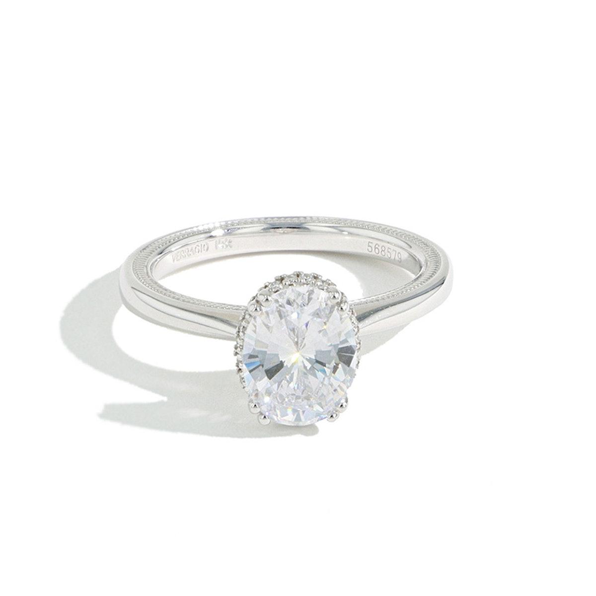 J.R.DUNN's oval diamond hidden halo engagement ring.