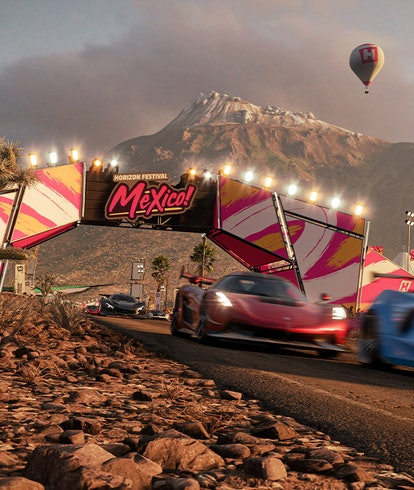 race cars driving past Forza Horizon Mexico sign