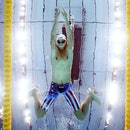 Michael Andrew of Team United States competes in heat five of the Men's 100m Breaststroke on day one...