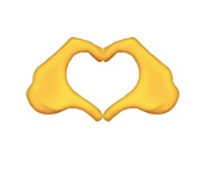 Hands in the shape of a heart is one of the new 2021 emojis.