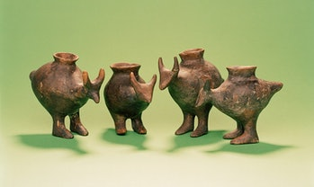 Photo shows four ceramic vessels each with an opening on top and shaped in the form of an animal wit...