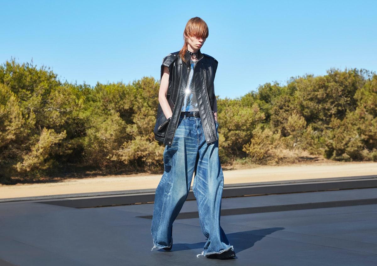 A model wearing baggy Celine Homme pants designed by Hedi Slimane