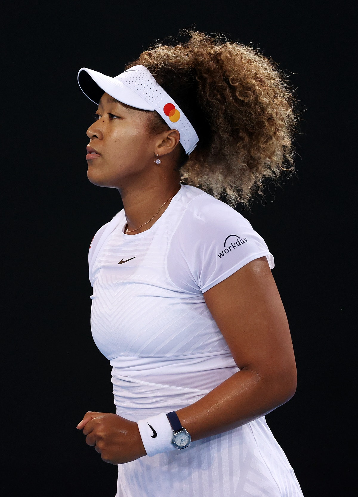 Naomi Osaka of Japan celebrates after winning a point in her Women's quarterfinals match against Iri...