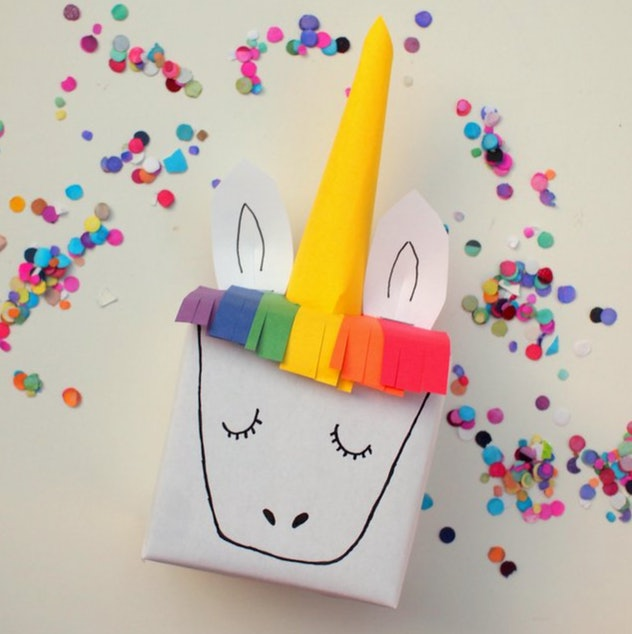 Unicorn gift wrap is a fun construction paper craft to make with kids.