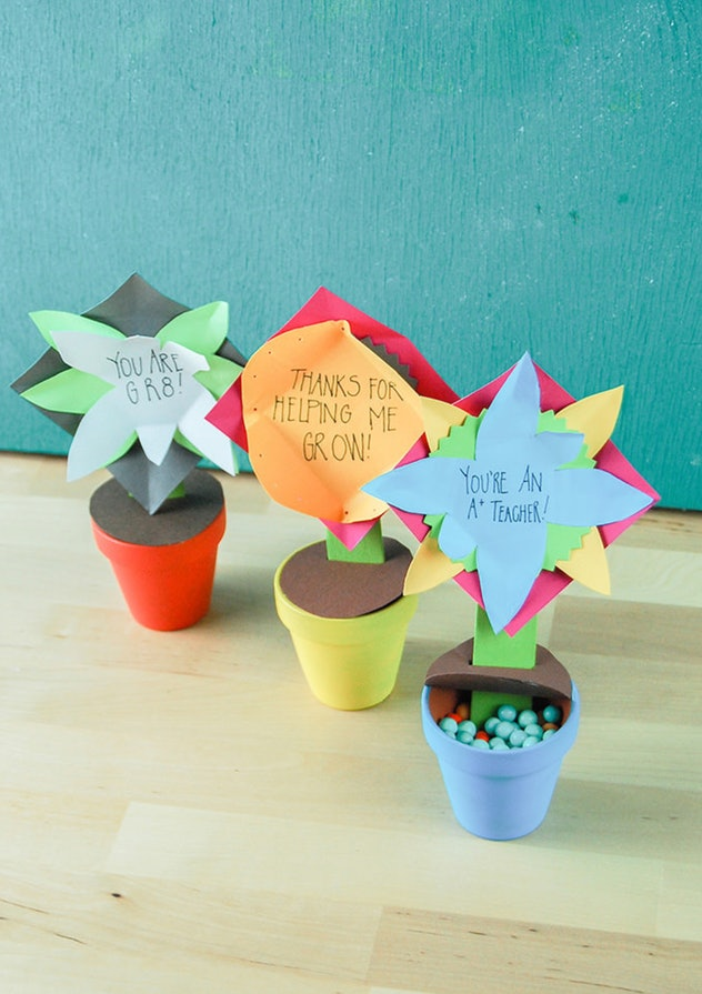 Flower pot gifts can be made using construction paper craft supplies.