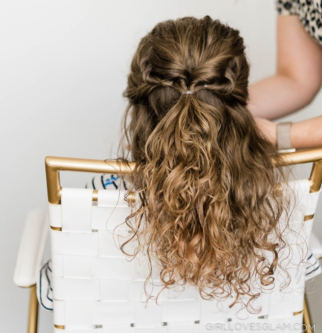 Back of a child's head; curly hair in a half-up style with twists
