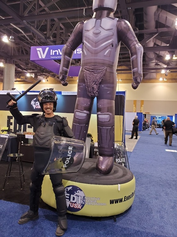 A man in riot gear at the National Sheriffs' Association Convention in Phoenix 2021
