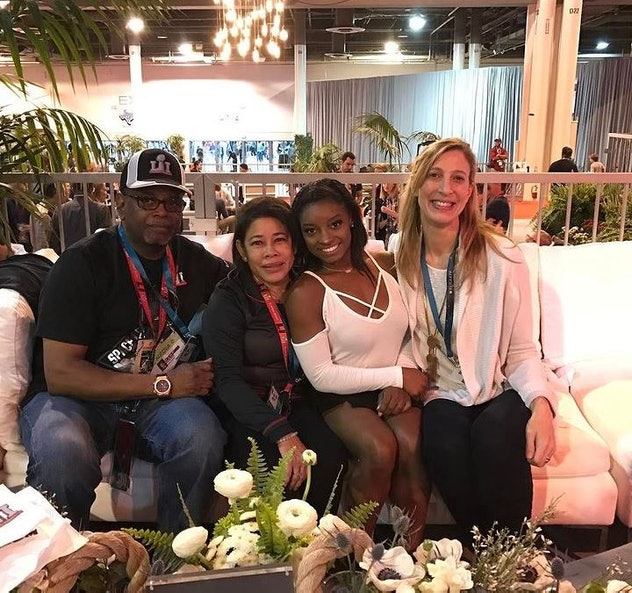 Simone and her parents, Nellie and Ronald at a 2017 Superbowl tailgate party.