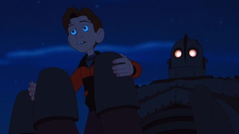 Hogarth in the Iron Giant's palm.