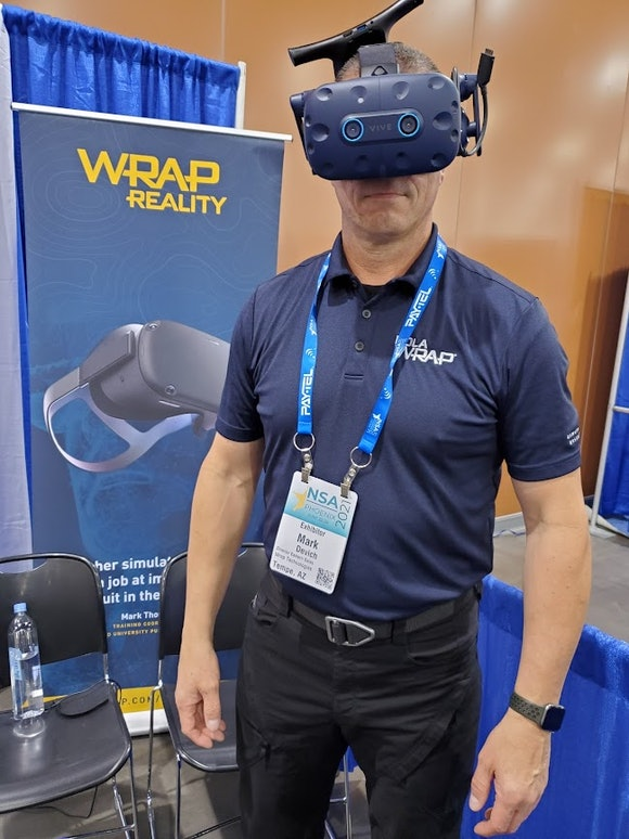 A man in VR headset at the National Sheriffs' Association Convention in Phoenix 2021