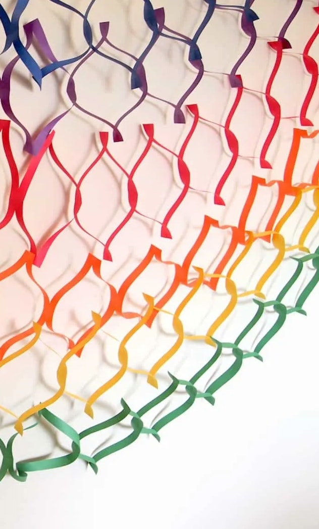 Paper garland is a decorative construction paper craft to make.