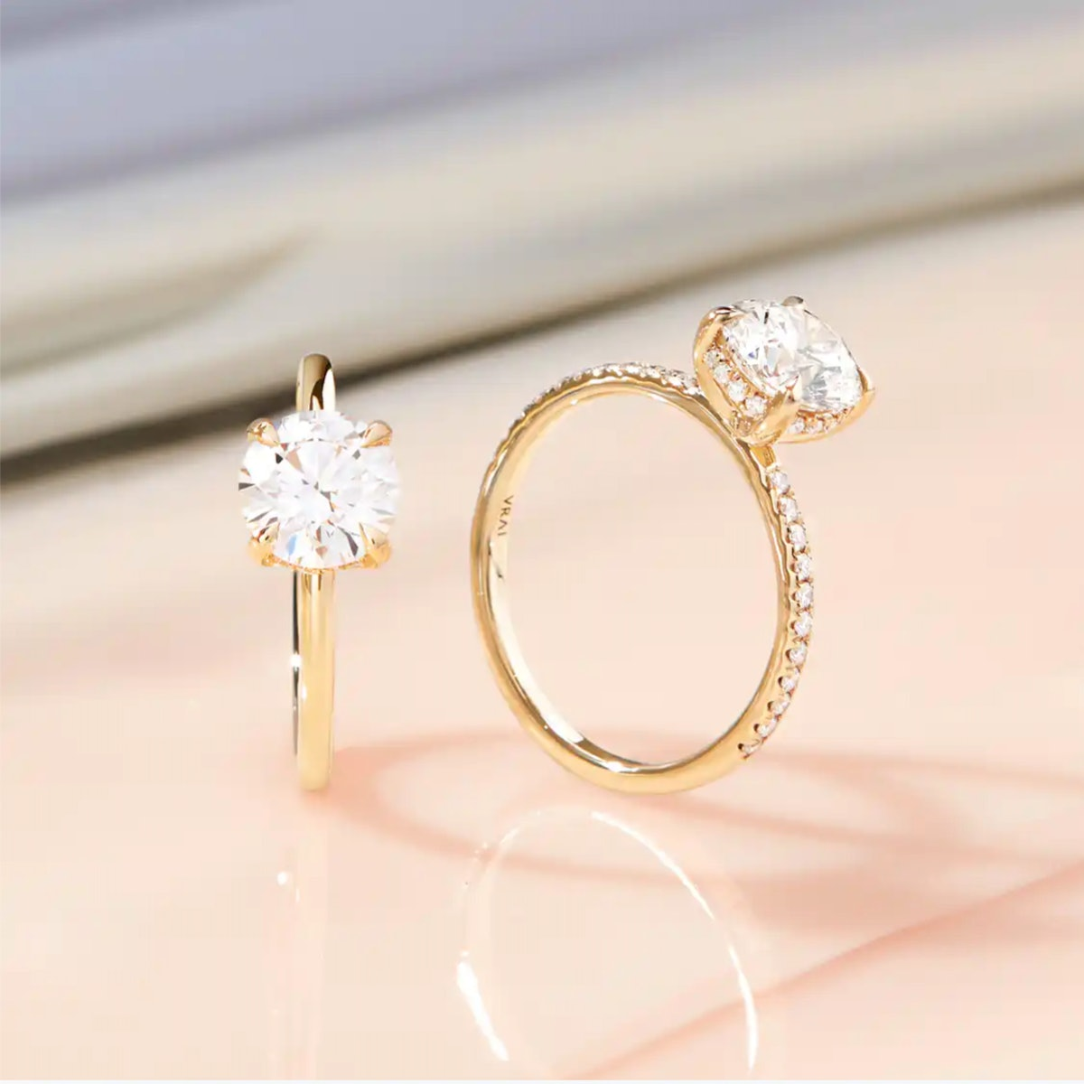 VRAI's round brilliant engagement ring with a classic hidden halo.
