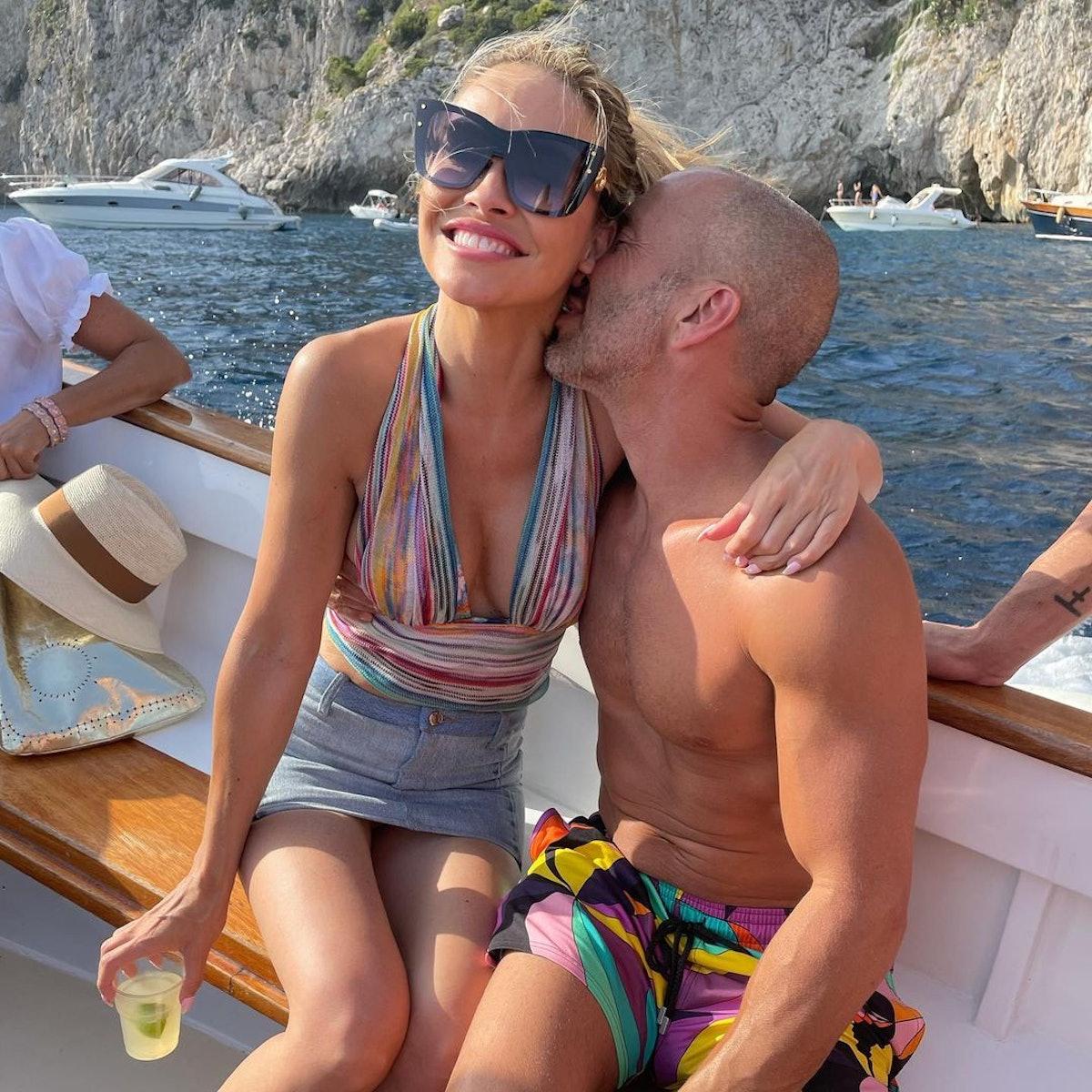 Jason nuzzling Chrishell's neck on a boat.