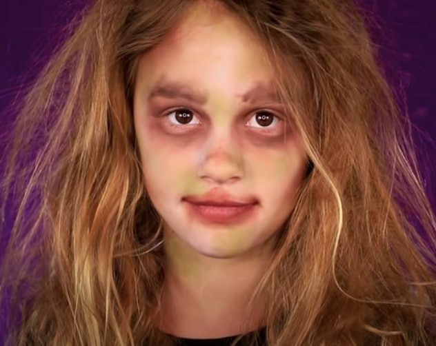 little girl dressed up like zombie
