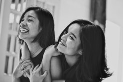 black and white photo of two sisters hugging and smiling