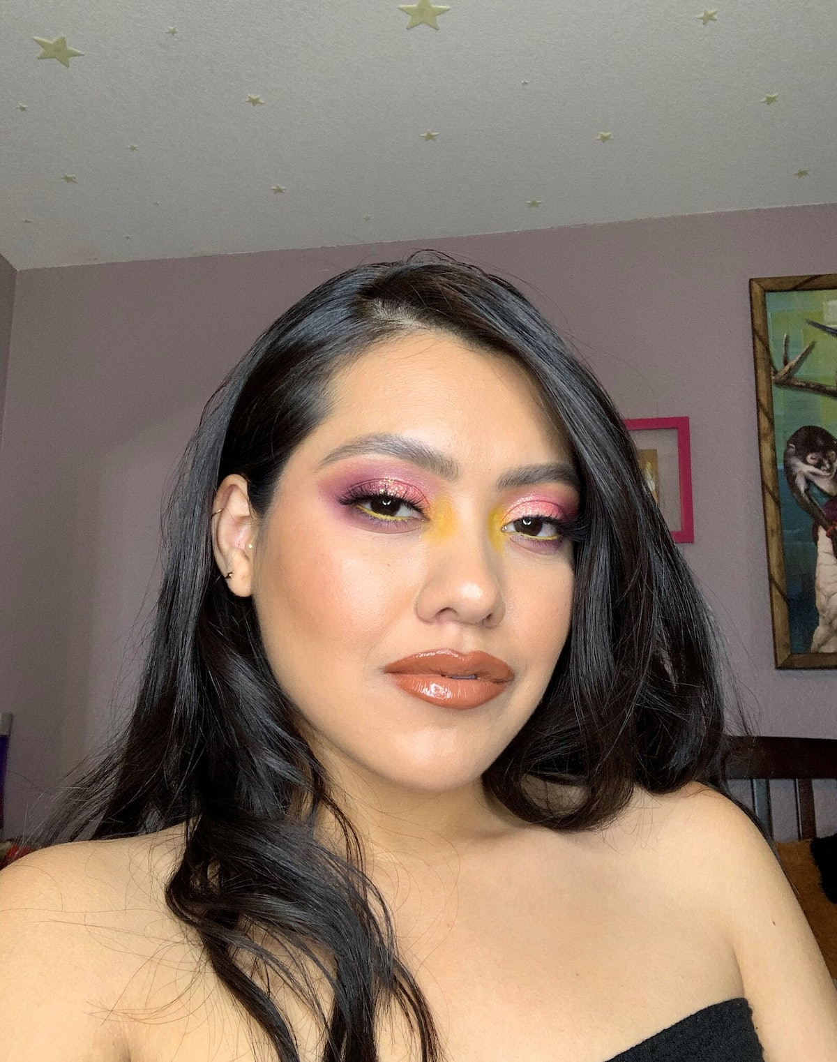 Diana, an e.l.f. Game Up Winner, wearing yellow and pink eyeshadow as well as a nude and glossy lip ...