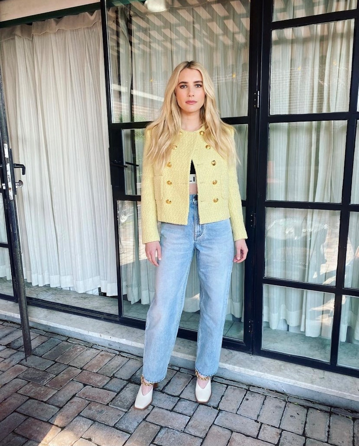 Emma Roberts wore jeans with her yellow Celine blazer for a book launch.