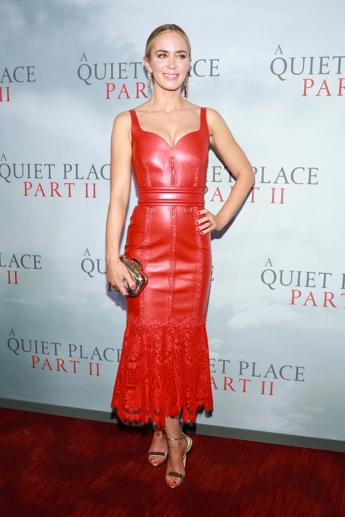 Emily Blunt in red leather dress.