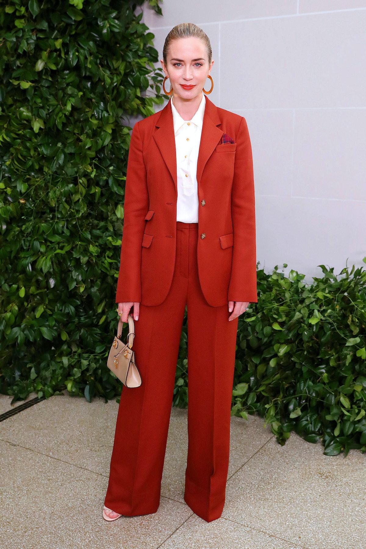 Emily Blunt in a blood orange suit.