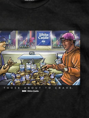 A closeup of a graphic on a t-shirt that shows two men sitting at a table covered by a mountain of w...